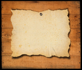 Old Empty Paper on old Wooden Boards