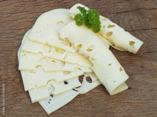 sliced cheese on a board from oak