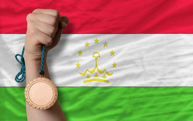 Bronze medal for sport and  national flag of tajikistan