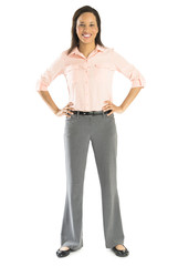 Confident Businesswoman Standing With Hands On Hips