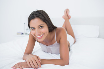 Woman relaxing lying in bed