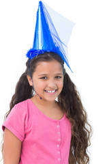 Little girl wearing blue hat for a party