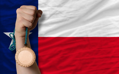 Bronze medal for sport and  flag of american state of texas