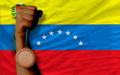 Bronze medal for sport and  national flag of venezuela