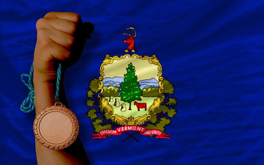 Bronze medal for sport and  flag of american state of vermont