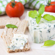 Blue cheese with a noble mould with diet bread, basiland tomato