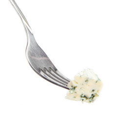 Blue cheese with a noble mould on fork on white background