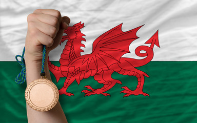 Bronze medal for sport and  national flag of wales