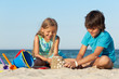 Kids playing on the beach building sand castle