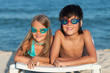 Kids with swimming goggles on the beach