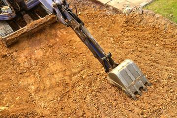 working excavator tractor