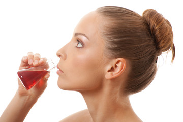 woman drinking a red liquid, isolated on white