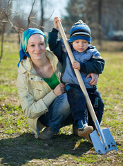 woman and boy working with spade