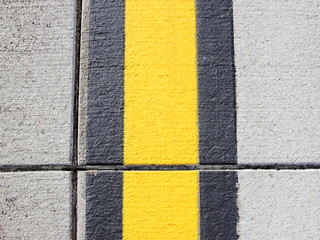 Yellow and black stripes on apron