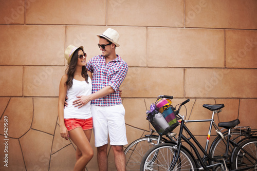Young couple standing against the wall and hugging