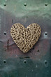 Wood heart on old metal background