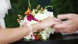 Giving a wedding bouquet