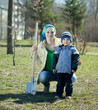 woman and boy  with spade