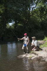 Fly fishing gillie instructing a pupil River Lyd Devon