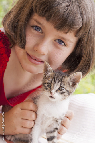 Little girl holding kitten