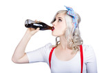Fifties pin-up promo woman drinking soft drink