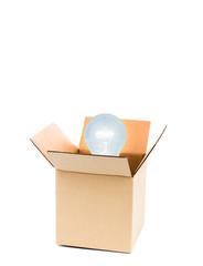 Glowing light bulb  over opene cardboard box