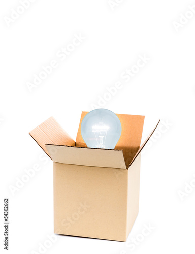 Glowing light bulb  over opene cardboard box