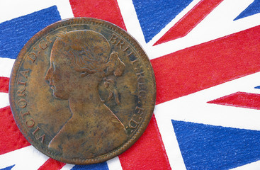 Queen Victoria one penny coin from 1864 on British flag backgrou