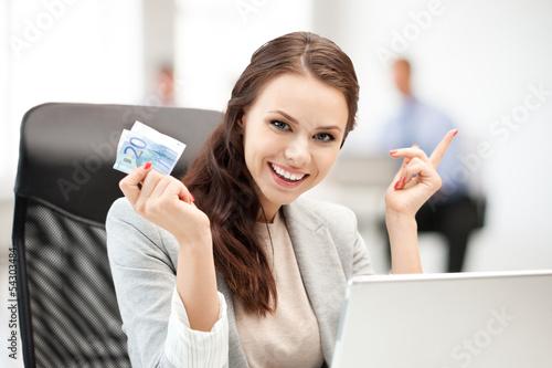 pensive businesswoman with cash money
