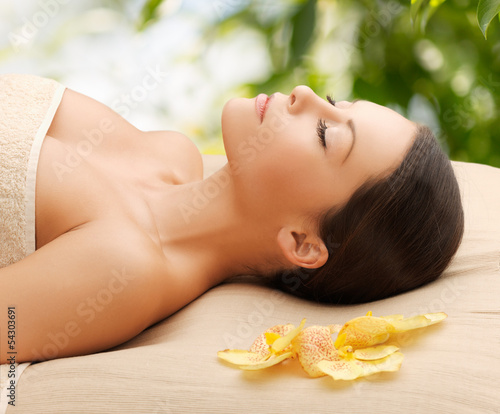woman in spa lying on the massage desk