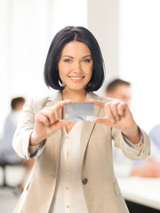 businesswoman showing credit card
