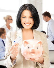 woman with piggy bank and cash money