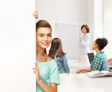 smiling student girl with white blank board