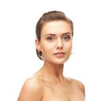 beautiful woman wearing gold earrings