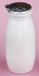 white bottle on pink background