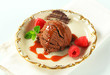 Chocolate brownie ice cream with caramel sauce and raspberries