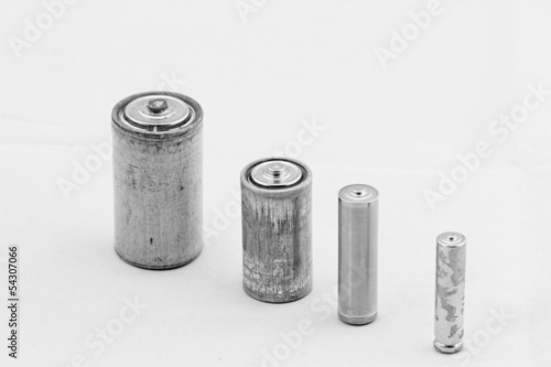 Old batteries on white background