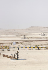 Broad view of oil wellhead and Oil pumps in Bahrain oil field