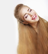 Sincere Smile. Jubilant Woman with Flowing Healthy Hairs