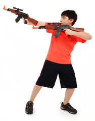 Handsome French American Boy Aiming Two  Plastic Toy AK47 To Sid