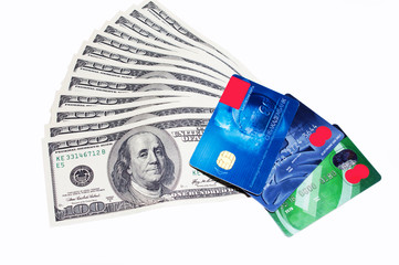 Some credit cards, dollars, notes isolated white background