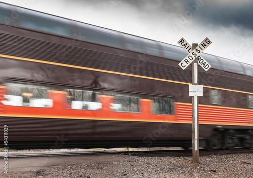 Foto op Aluminium Beijing Brown Passenger Car Flies by Railroad Crossing