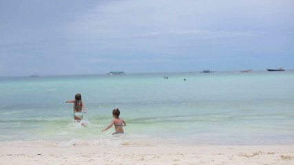 two little sisters at tropical beach in Philippines