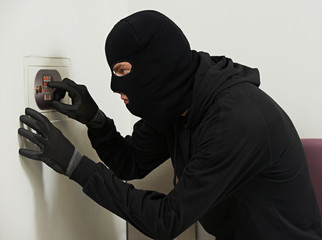 thief burglar at house code breaking