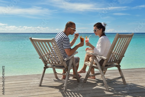 happy young couple relax and take fresh drink