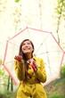 Asian Autumn woman happy after rain under umbrella