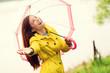 Fall woman happy after rain walking umbrella