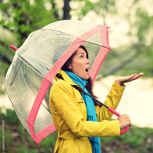 Umbrella woman in Autumn excited under rain