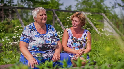 Older women, female talking outdoors