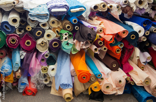 Bolts/rolls of various colored fabric - 54318471